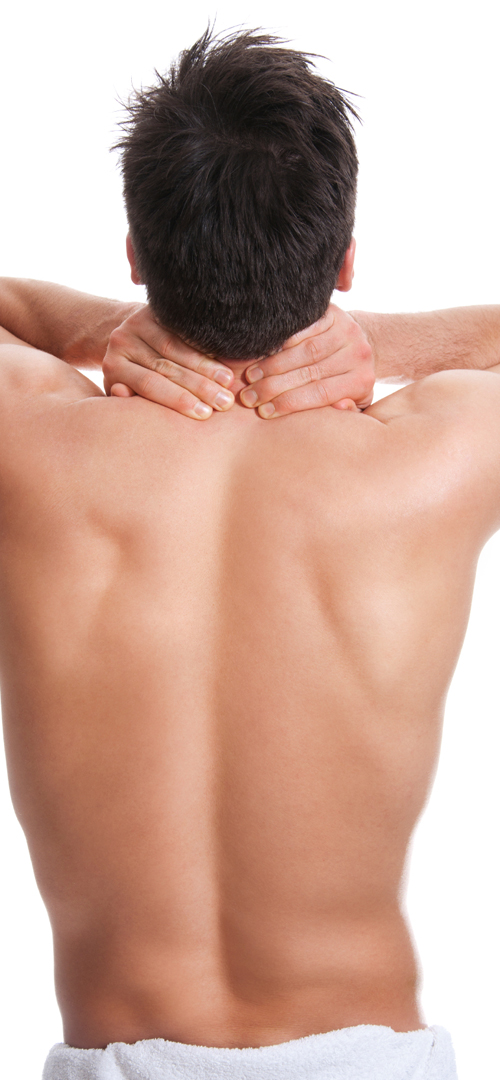 man rubbing his neck after a back wax